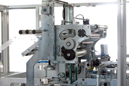 Packaging machine for rolls, serviettes and handkerchiefs. Stock Photo - 9110367