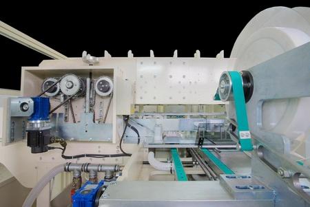 handkerchiefs: Details of a packaging machine for rolls, serviettes and handkerchiefs. Stock Photo