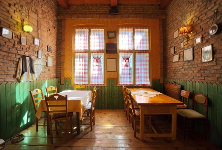 taverns: Interior of an old tavern, traditional Serbian style, souvenirs and old wooden furniture.  Stock Photo