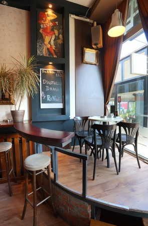 Interior of a modern cafe, furniture, lighting equipment and decoration.  photo