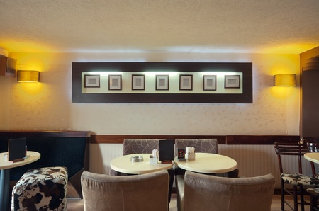 luxury restaurant: Interior of a modern cafe, furniture, lighting equipment and decoration.