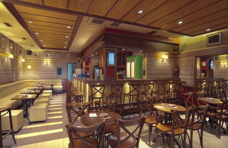cafeteria: Cafe interior with wooden furniture, lighting equipment and decoration.