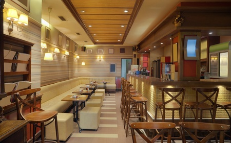 Cafe interior with wooden furniture, lighting equipment and decoration. photo