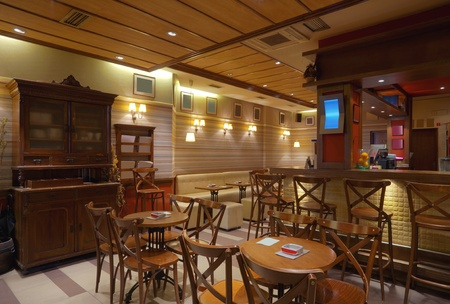bar interior: Cafe interior with wooden furniture, lighting equipment and decoration.