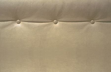 Part of a beige leather seat with three buttons on it.  Stock Photo - 9271060