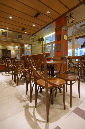Cafe interior with wooden furniture, lighting equipment and decoration. Stock Photo - 9271058