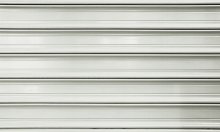 Part of a metal garage wall in gray and white. Stock Photo - 9271038