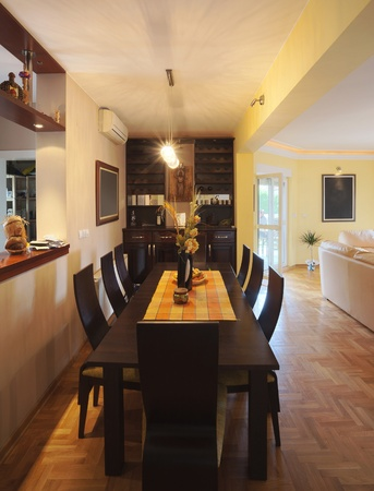 Interior of a dinning room with wooden furniture.  photo
