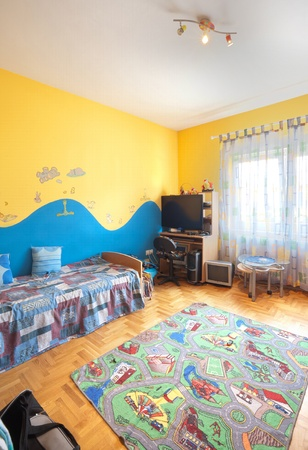bed room: Interior of a kid-room with furniture and two colors painted walls.