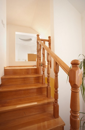 Wooden stairs in house, interior decoration, wood and white walls. photo