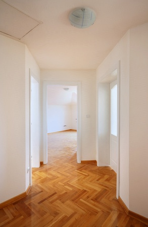 Interior of a new home, empty room with white walls and parquet. Stock Photo - 9968166