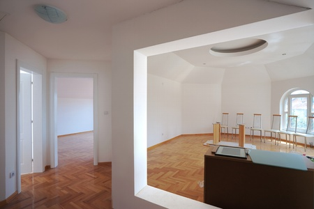 Interior of a new home, empty room with white walls and parquet. Stock Photo - 9968163