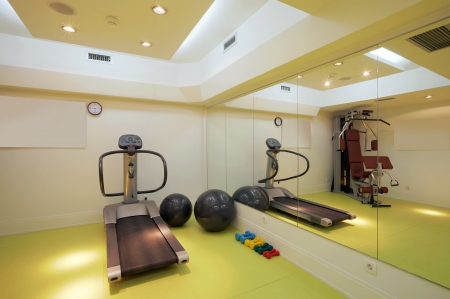 gymnasium: Interior of an empty fitness club with equipment.