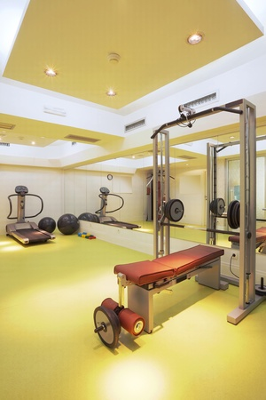 weightlifting equipment: Interior of an empty fitness club with equipment.