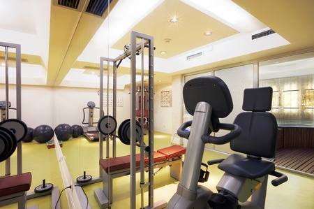 gym room: Interior of an empty fitness club with equipment.