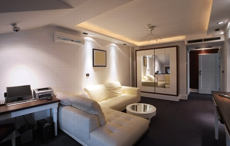 Interior of a hotel apartment with furniture, modern contemporary design.  photo