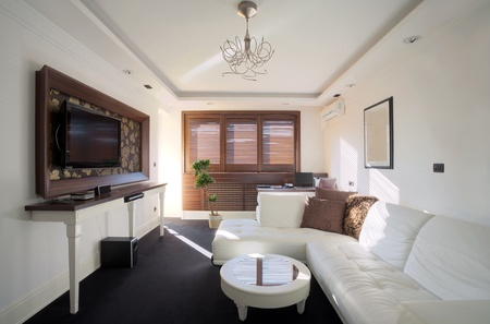 Interior of a hotel apartment with white walls and furniture during daytime. Stock Photo - 10407280