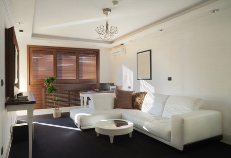 Inter of a hotel apartment with white walls and furniture during daytime. Stock Photo - 10407281