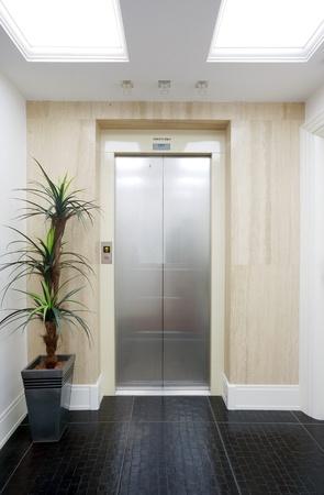 elevators: Closed elevator door in a hotel.