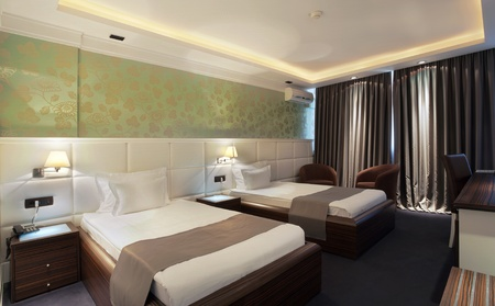 hotel room: Interior of a hotel apartment with white walls and furniture during daytime