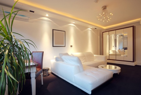decor: Interior of a hotel apartment with furniture, modern contemporary design.