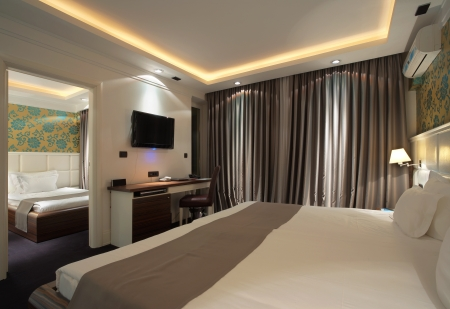 hotel building: Interior of a hotel apartment with furniture, modern contemporary design.