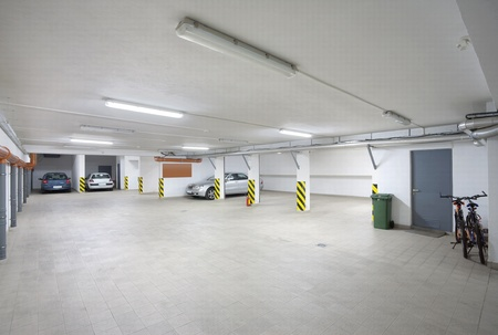 Interior of a hotel garage, simple, empty and white.
