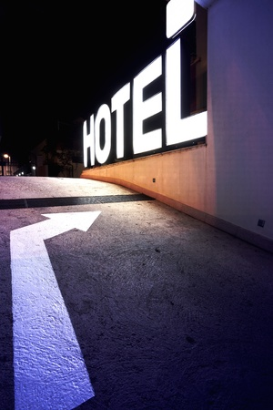 accommodation: Entrance of a hotel, light letters.