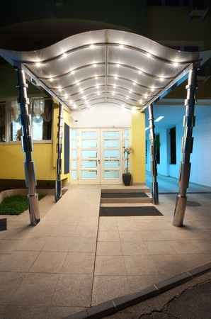 Entrance of a hotel, modern metal design.  photo