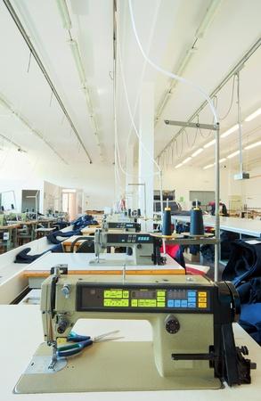 warehouse interior: Sewing factory warehouse interior, various materials inventory. Stock Photo