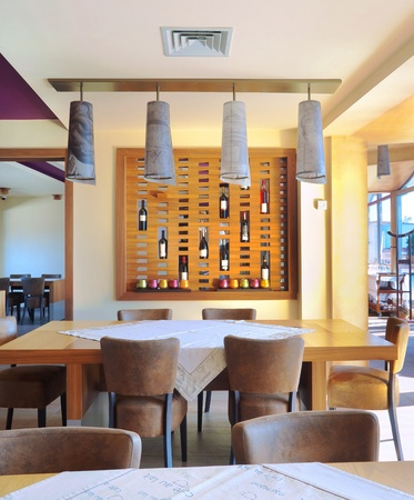 ceiling design: Part of a restaurant interior, drinks and lamps as decoration.