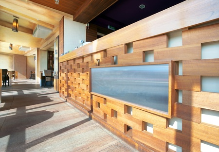 Cafe interior, details of a modern wooden bar.  photo
