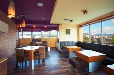 Interieur van een moderne cafà meubelen verlichtingsartikelen