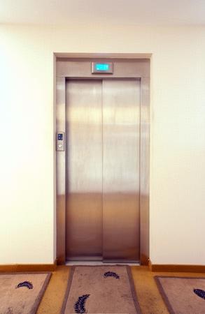 Metal elevator door, modern design, interior of a hotel halls.  photo