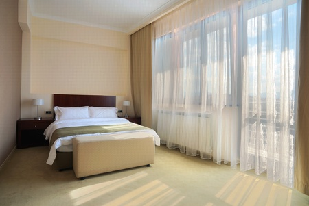Interior of a hotel bedroom, with double bed.
