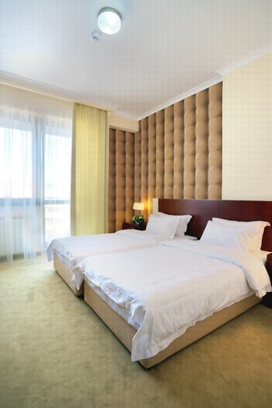 Interior of a hotel bedroom, with double bed. photo