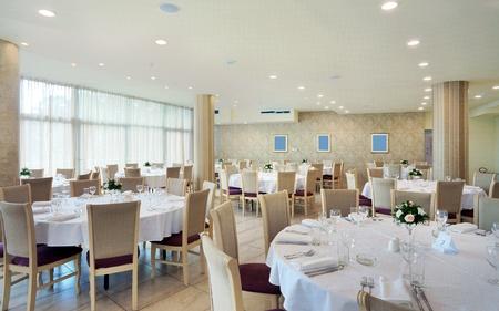 Interior of a restaurant prepared for wedding ceremony.