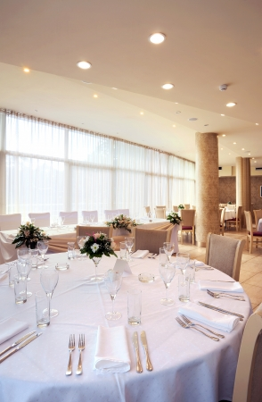Interior of a restaurant prepared for wedding ceremony.  photo
