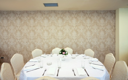 Interior of a restaurant prepared for wedding ceremony.  Stock Photo - 11184232
