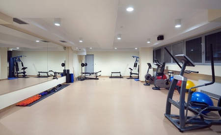 wall mirror: Interior of a hotel fitness club equipped with fitness devices.    Stock Photo