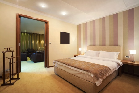 double rooms: Interior of a hotel room for two, one part of a large apartment.