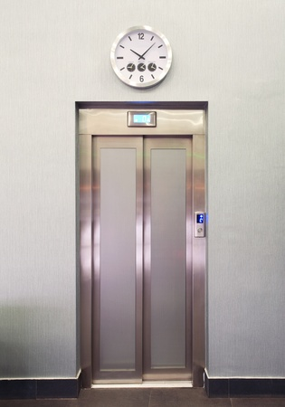 Closed metal elevator door details, modern design, interior of a hotel.  Stock Photo - 11293582