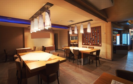 Interior of a modern restaurant, classical design, by night.