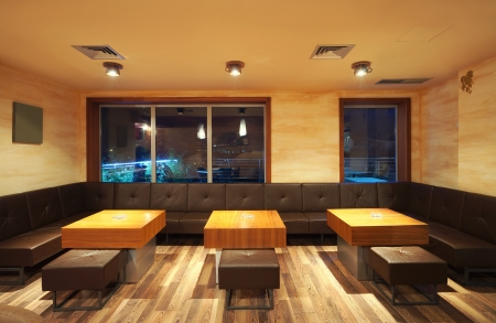Interior of a modern restaurant, classical design, by night.  photo
