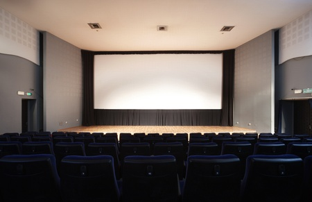 empty stage: Cinema interior, empty seats, modern design.