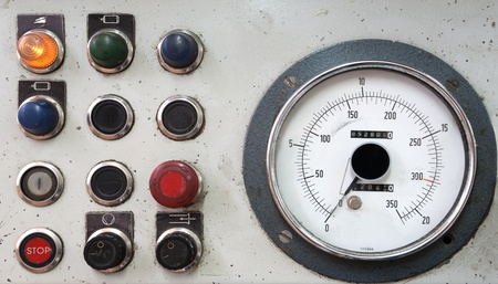 Details of a control desk, old and dirty, part of a machine.  photo