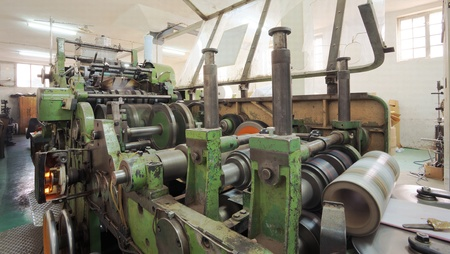 Details of a printing machine inside factory.  photo