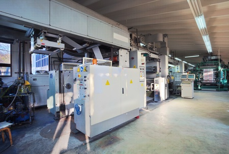 offset: Details of a printing machine inside factory.