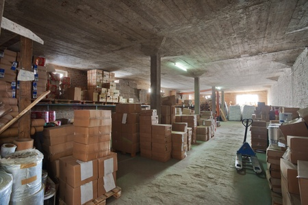 factory floor: Interior of a warehouse in a printing factory, raw materials in stock.