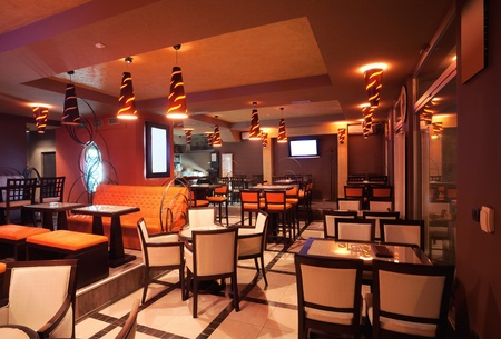 wall bars: Interior of a restaurant, modern design in few colors, orange and brown   Stock Photo
